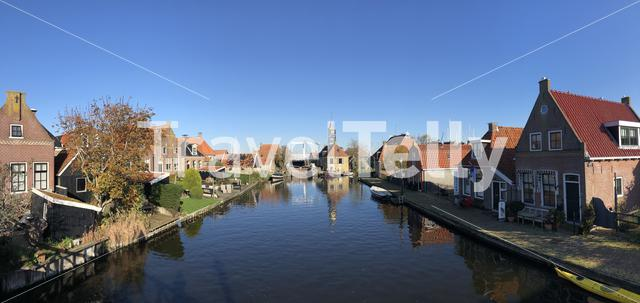 Panorama from a canal in Hindeloopen during autumn in Friesland, The Netherlands