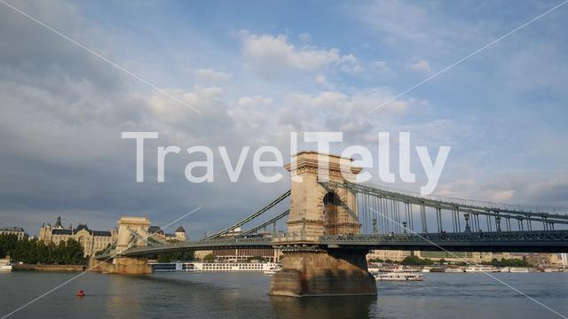 The Széchenyi Chain Bridge is a suspension bridge that spans the River Danube between Buda and Pest sides of Budapest Hungary