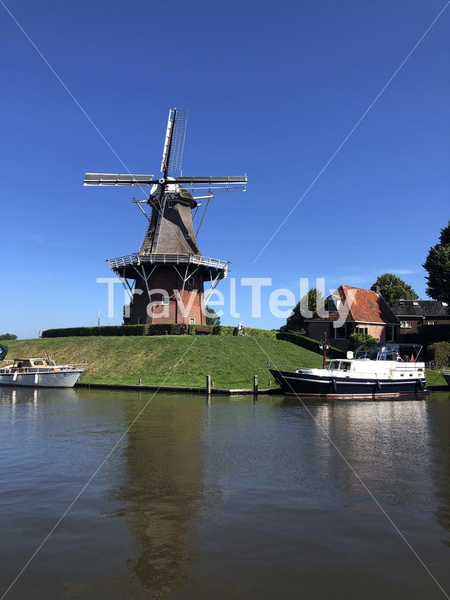 Windmill next to a canal in Dokkum, Friesland The Netherlands