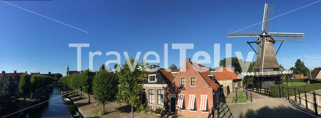 Panorama from a canal, houses and a old windmill in Sloten Friesland The Netherlands