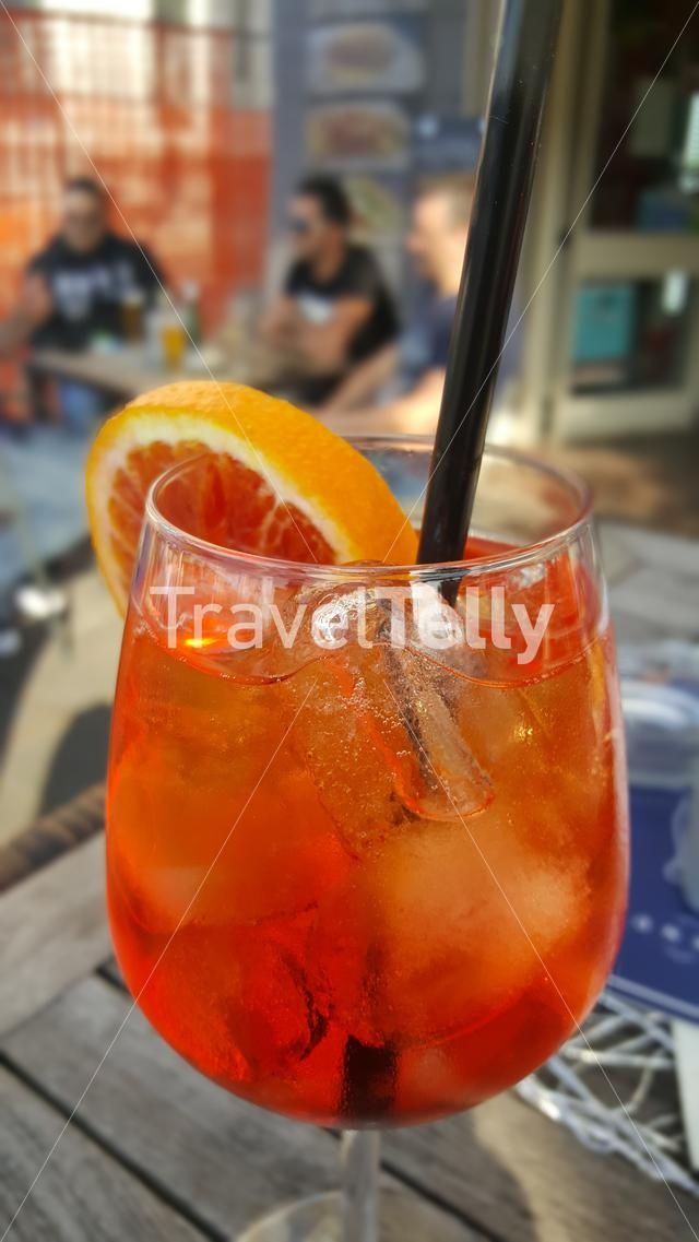 Glass with tasty Aperol spritz on terrace