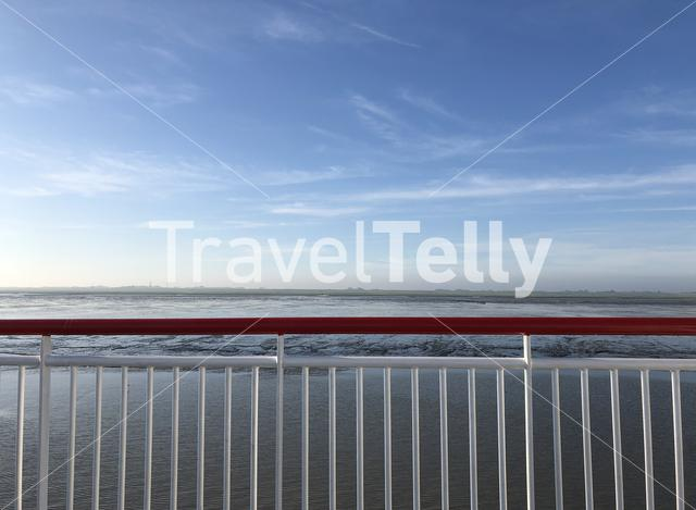 View from a ferry towards Ameland during low tide in Friesland The Netherlands