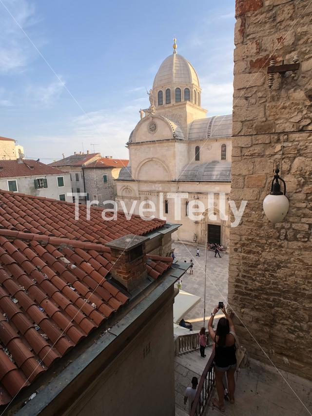 Tourist photgraphs the Cathedral of St. James in Sibenik, Croatia