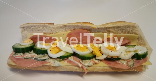 Sandwich healthy with ham, cheese, egg, cucumber and dressing sauce