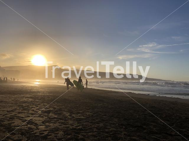 Surfers during sunset at the beach of Las Palmas, Gran Canaria