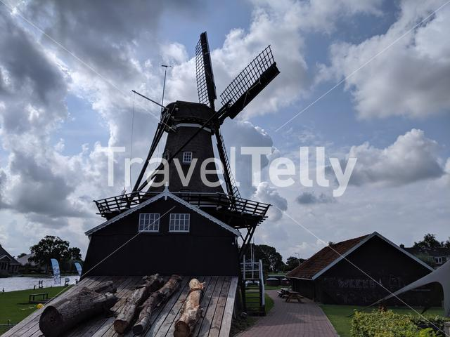 Dark clouds above the windmill in Woudsend, Friesland The Netherlands