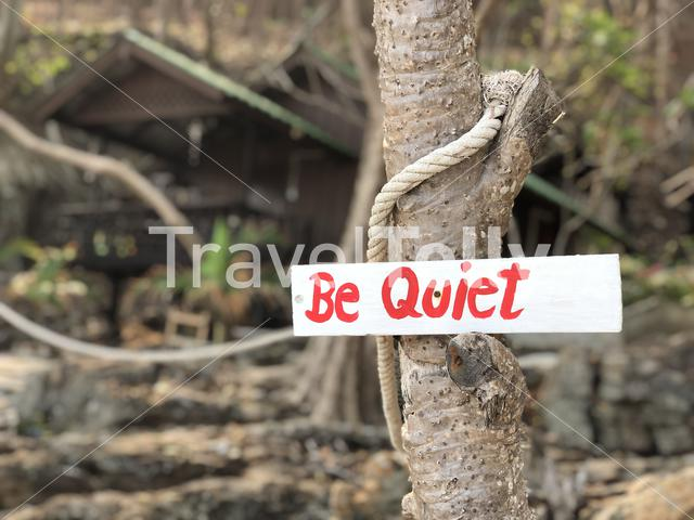 Be quiet sign at a bungalow on island Koh Samet in Thailand