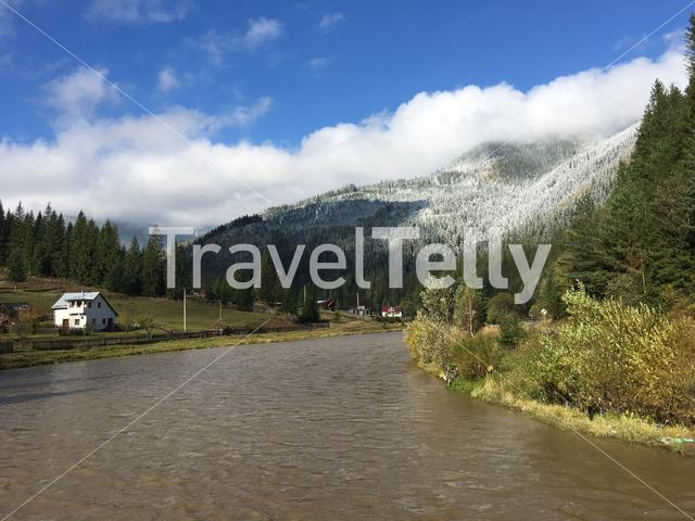 Snowy mountain landscape with the river Dorna in Romania