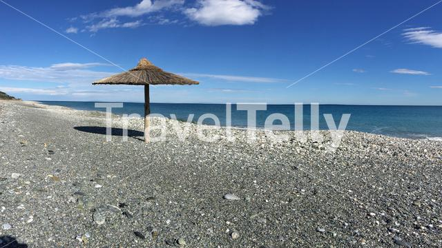 Panorama from Velika beach with a parasol in Greece