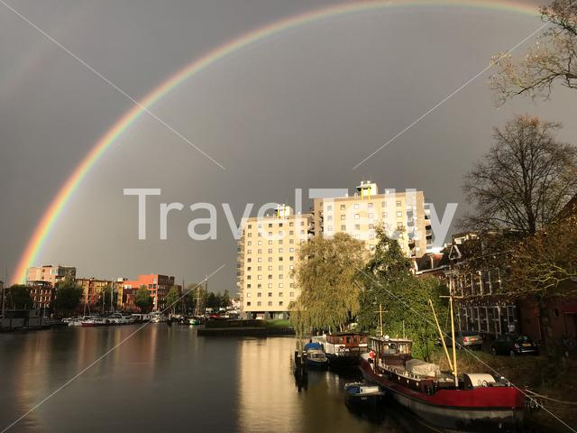 Rainbow above a canal in Groningen The Netherlands