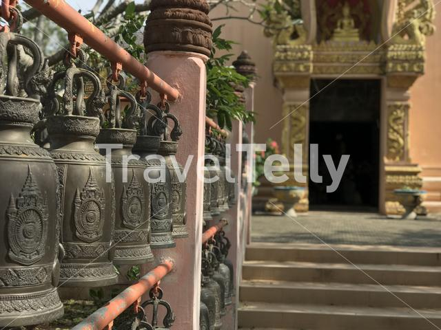 Bells at a Buddhist temple in Phanom Sawai Forest Park Thailand