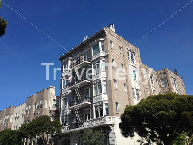 Apartment building in Franklin street San Francisco with American flag