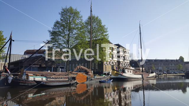 Dutch canals with boats in City of Gouda, The Netherlands