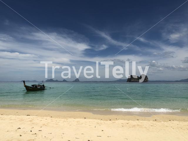 Long-tail boat close to the beach of Koh Ngai in Thailand