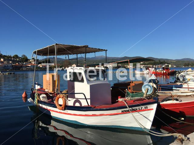 Fishing boats in the bay of Achillio Greece