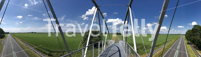 Panorama from a bridge over a road near Wommels in Friesland, The Netherlands