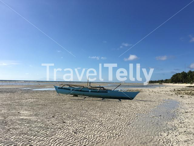 Catamaran Boat during low tide at Anda beach in Bohol the Philippines