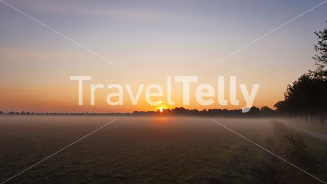 Dutch landscape over farmland at sunrise