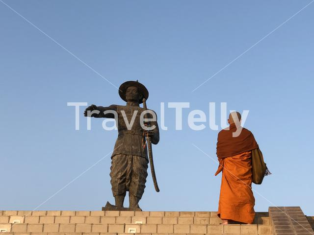 Monk looking at the Chao Anouvong Statue in Vientiane Laos