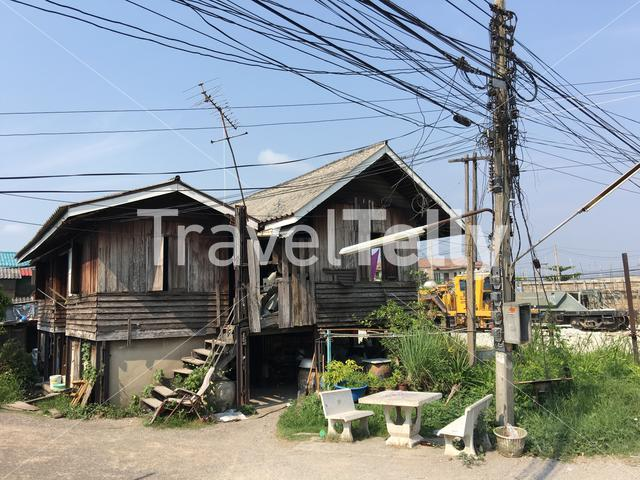 Wooden house next to the railway in Tha Chalom Thailand