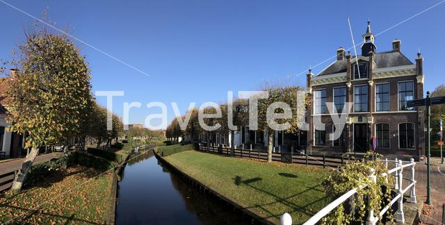 Canal in IJlst panorama during autumn in Friesland, The Netherlands
