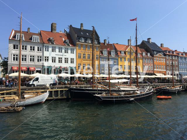 Nyhavn (New Harbour) is a 17th-century waterfront, canal and entertainment district in Copenhagen, Denmark
