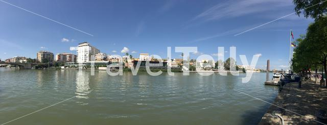 Panorama from the Canal de Alfonso XIII seen from Puente de S. Telmo in Seville Spain
