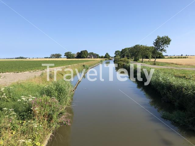 Farmland and a canal around Sint Annaparochie in Friesland The Netherlands