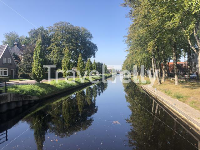 Canal through Oosterwolde in Friesland The Netherlands