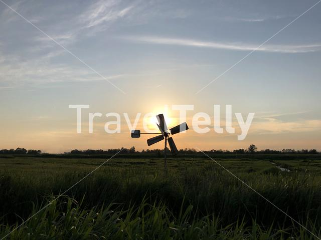 Windmill during sunset in Friesland, The Netherlands