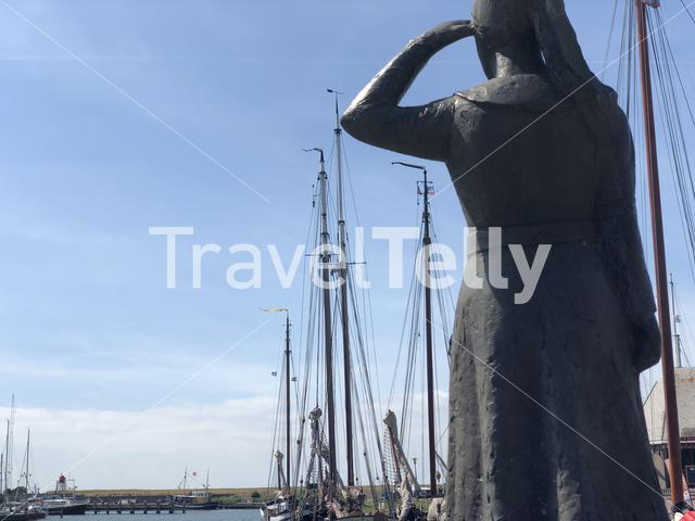 Lady of Stavoren statue in the harbor of Stavoren, Friesland The Netherlands