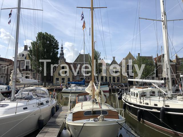 Sailboats in the north harbor canal in Harlingen, Friesland The Netherlands