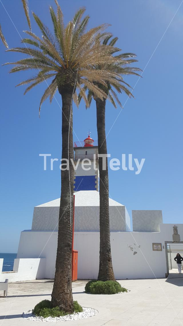 Lighthouse in Cascais, Portugal with palm trees
