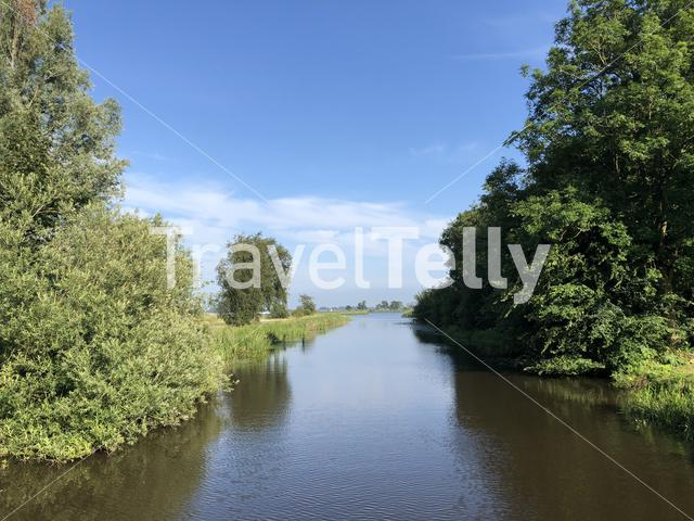 Canal towards the Sneeker lake in Friesland The Netherlands