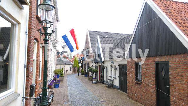 Dutch street with dutch flag in Ootmarsum, Twente, Holland