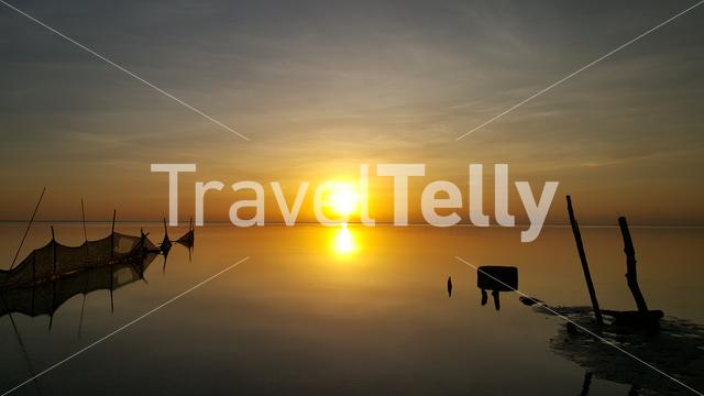 fishing nets in the sea at sunrise