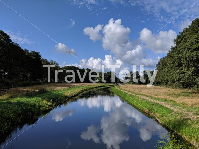 Clouds reflection in a river around Westerbork, Drenthe The Netherlands