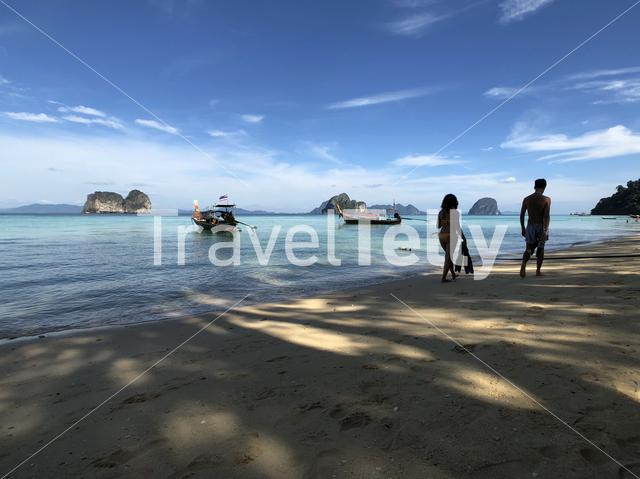 Tourists walk on the beach of Koh Ngai in Thailand