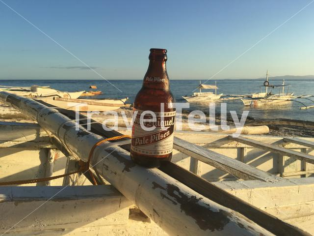 Bottle of beer from San Miguel at a Catamaran Boat  at the beach of Balicasag Island in Bohol the Philippines