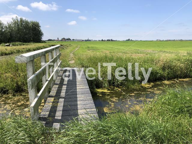 Bridge over a canal at farmland around Abbegea in Friesland The Netherlands