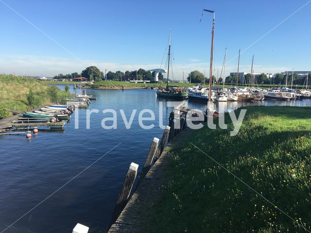 Boats on a summer day in the harbour of Vollenhove The Netherlands