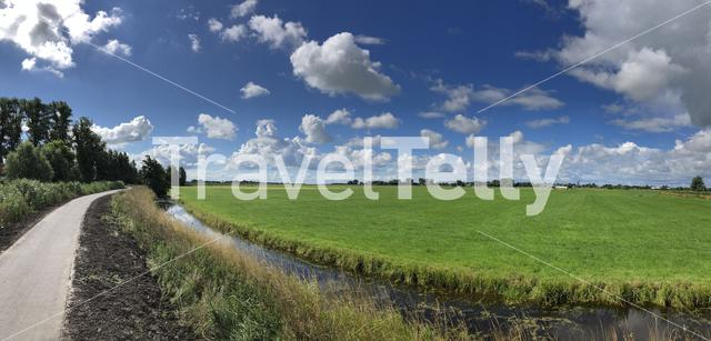 Cloudy frisian landscape panorama around Sneek, Friesland The Netherlands