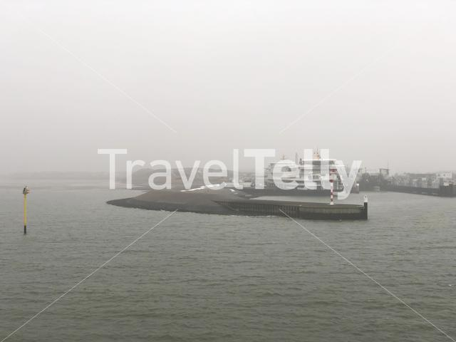 Misty harbor of Texel island in The Netherlands