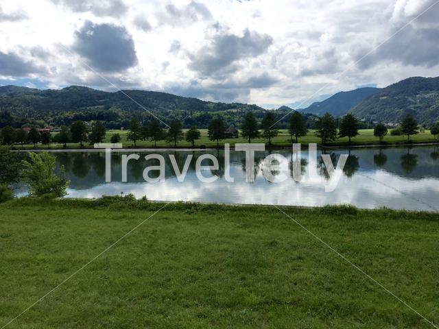 Trees reflection in the Sava river at the countryside of Slovenia