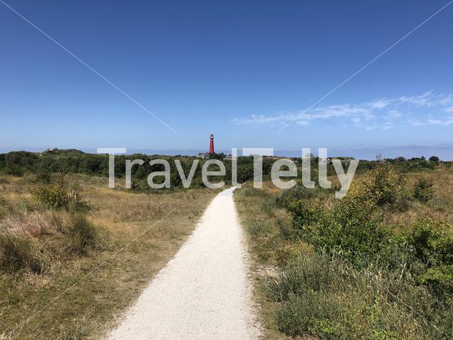 Path towards the lighthouse on Schiermonnikoog in The Netherlands