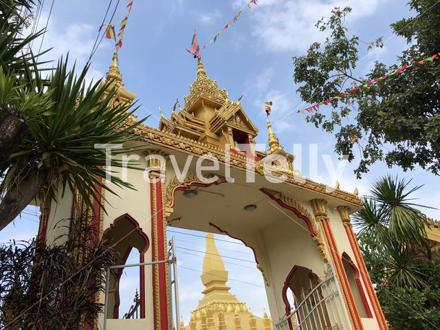 Gate towards the Gold Buddhist stupa Pha That Luang Vientiane in Laos