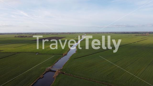 Farmland and a canal around Sneek in Friesland The Netherlands