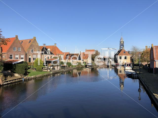 Canal in Hindeloopen during autumn in Friesland, The Netherlands
