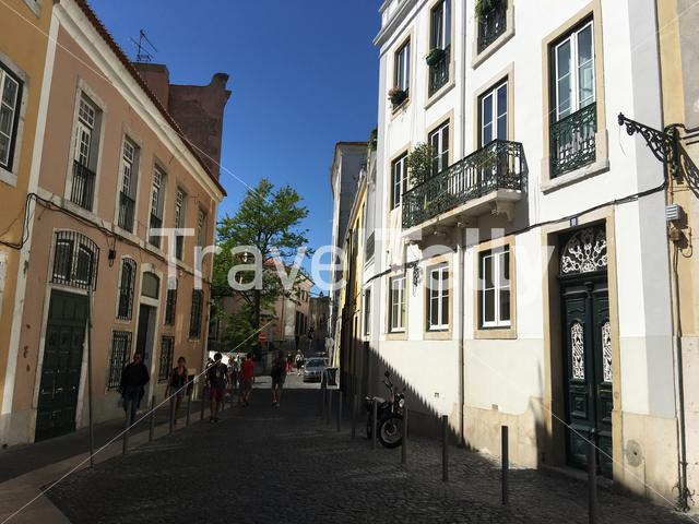 Historical street with people in Lisbon portugal