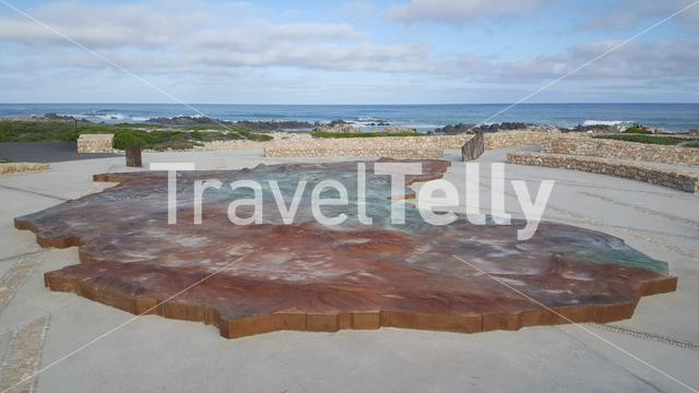 Monument at coast of Cape Agulhas in South Africa